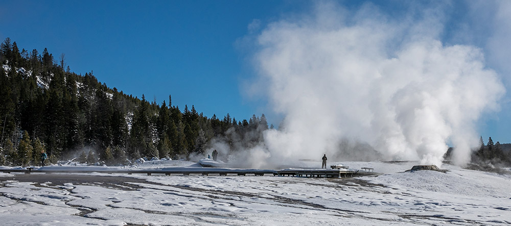 visitors-on-winter-snow-covered-geyser-hill-in.jpg