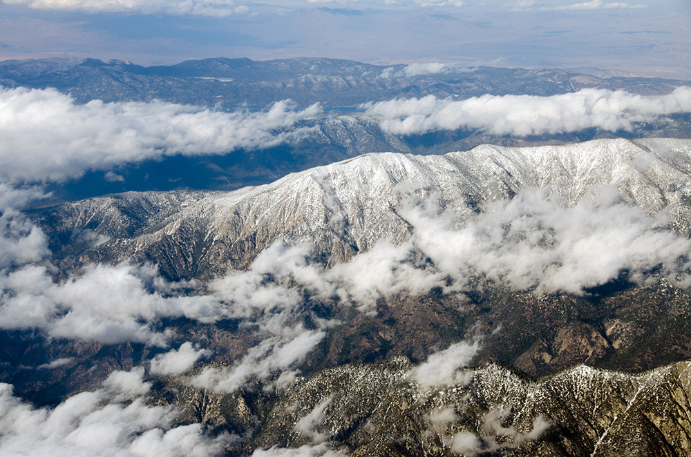 aerial-view-clouds-snow-covered-mountains-southern-california.jpg