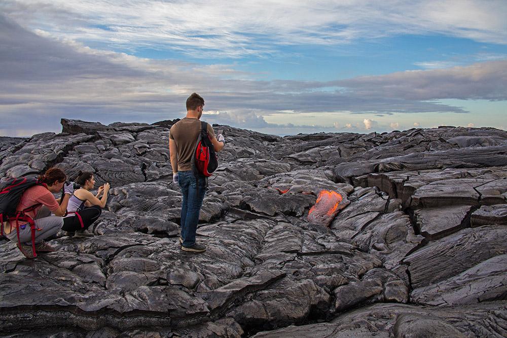 hikers-taking-photos-of-lava-breakouts-in-hawaii.jpg