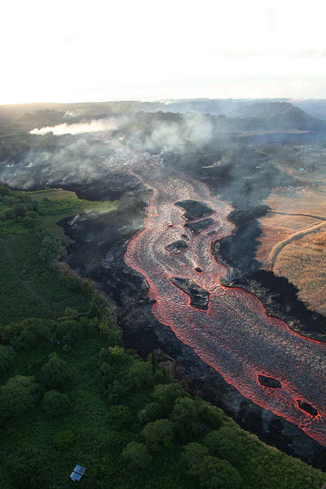lava-from-fissure-glowing-orange-throughout-its-journey.jpg
