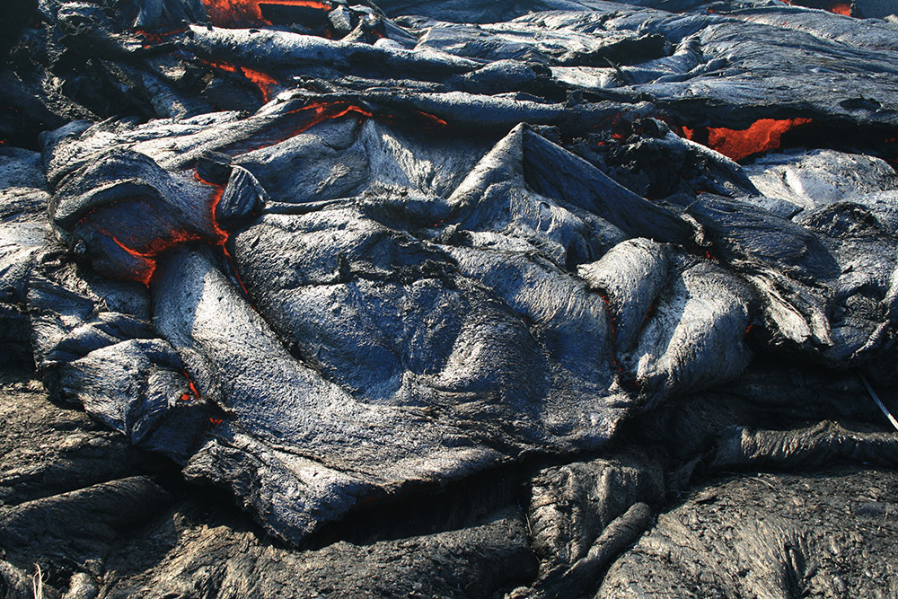 sluggish-pahoehoe-briefly-spills-over-a-section-the-levee.jpg