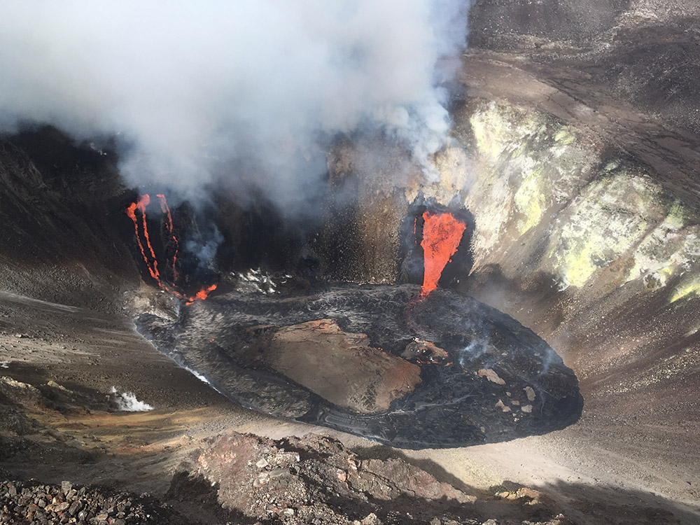two-streams-of-lava-pour-down-the-sides-of-volcano-into-the-growing-lava-lake-at-the-bottom.jpg