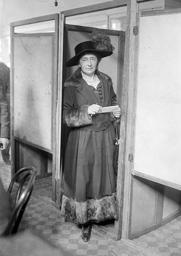 margaret-lally-at-the-door-of-a-voting-booth-during-the-first-election-where-women-could-vote-new-york-city-1918.jpg