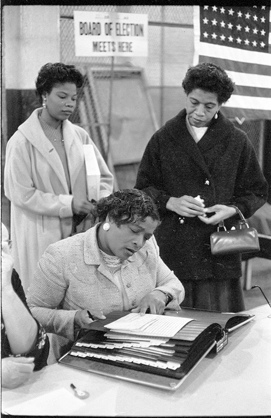 three-african-american-women-at-a-polling-place-one-looking-at-a-book-of-registered-voters-on-november-5-1957-in-new-york-city.jpg