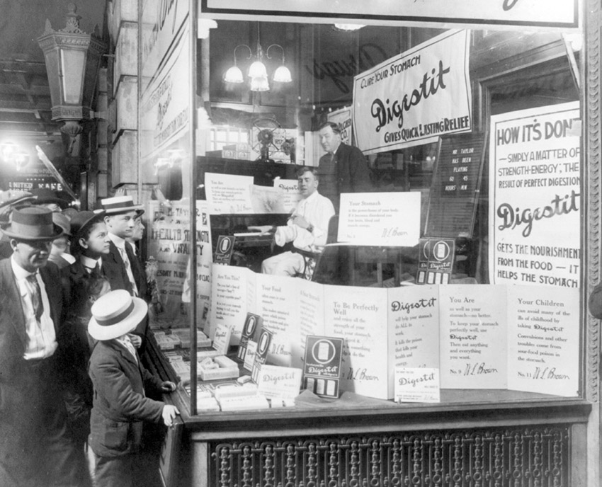 shoppers-looking-into-a-drug-store-1915.jpg