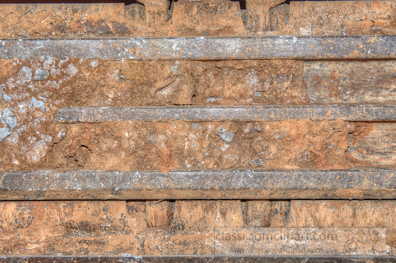 Excavator-Heavy-construction-equipment-closeup-tracks-with-dirt-Photo-.jpg