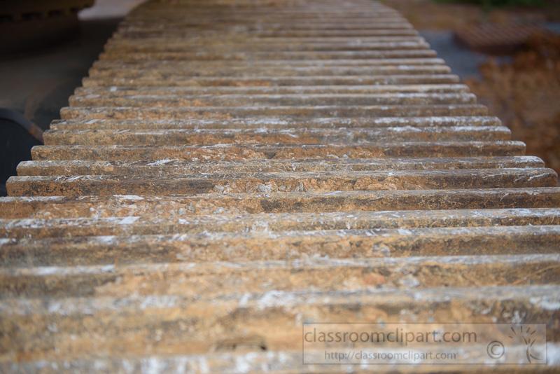 Excavator-Heavy-construction-equipment-closeup-tracks-with-dirt-Photo-8689.jpg