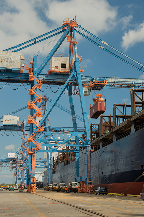 cargo-crane-loads-a-container-onto-a-cargo-ship-port-baltimore.jpg