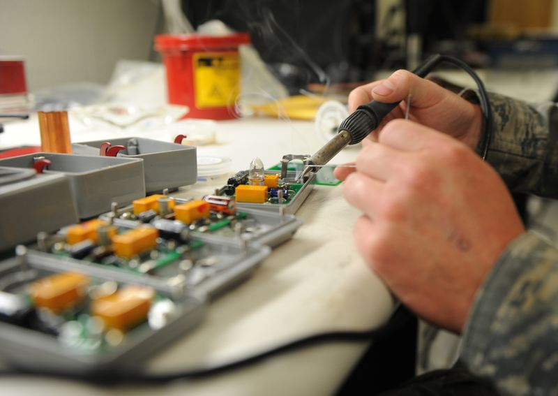 technician-working-on-light-circuit-board-photo.jpg