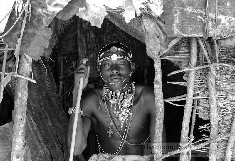 young-tribesman-inside-of-hut-in-africa-black-and-white-picture-22Aa.jpg