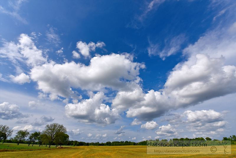 cummulus-clouds-over-agricultural-land-photo-image-1501A.jpg