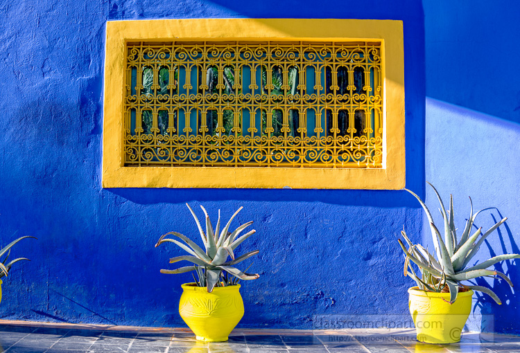 Bright-Blue-walls-with-Yellow-Window-Menara-gardens-Marrakeh-Morocco-Photo-Image-6922E.jpg