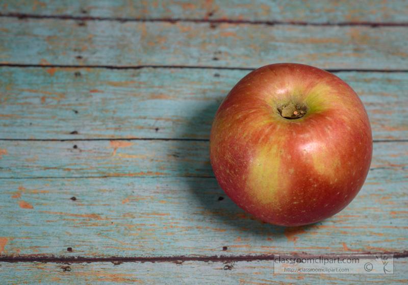 single-red-apple-on-wooden-background-79.jpg
