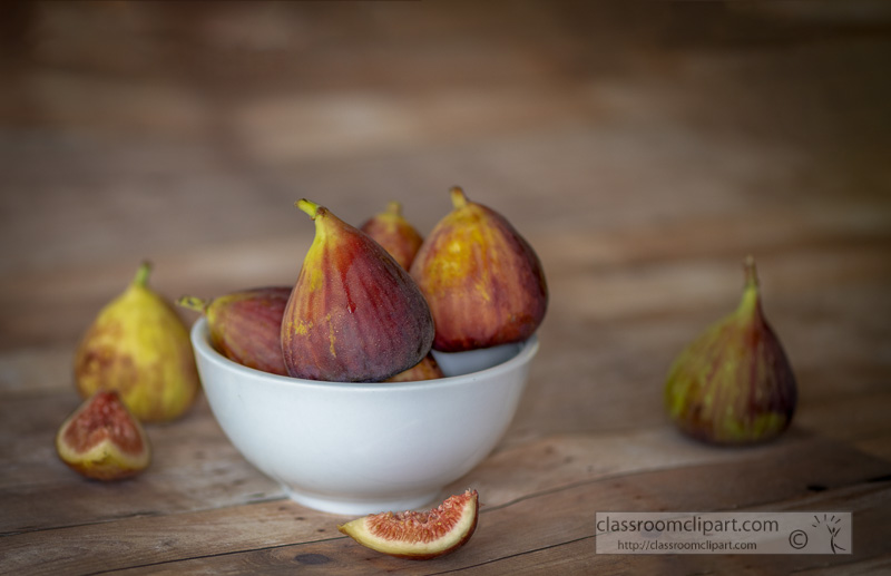 group-of-figs-in-a-white-bowl-wood-background-photo-.jpg