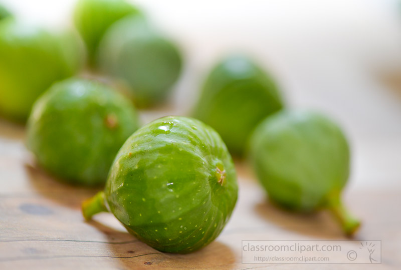 rows-of-green-figs-on-wood-background.jpg