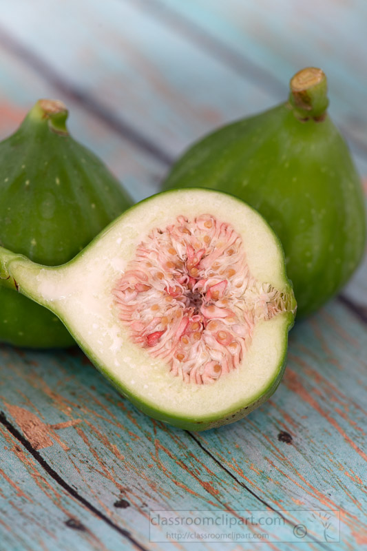 two-whole-green-figs-with-sliced-fig-in-front.jpg