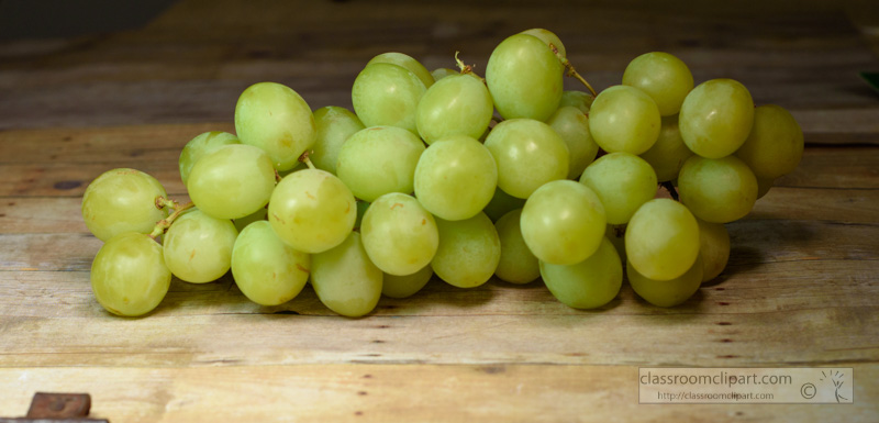 bunch-of-fresh-sweet-green-grapes-on-wood-background-photo-72E2.jpg
