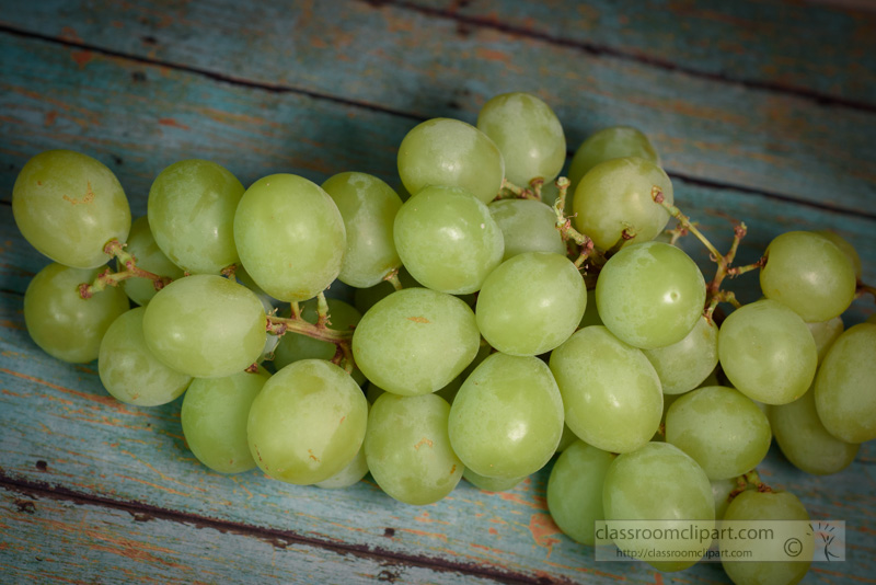 bunch-of-vitamin-filled-green-grapes-on-wood-background-photo-78.jpg
