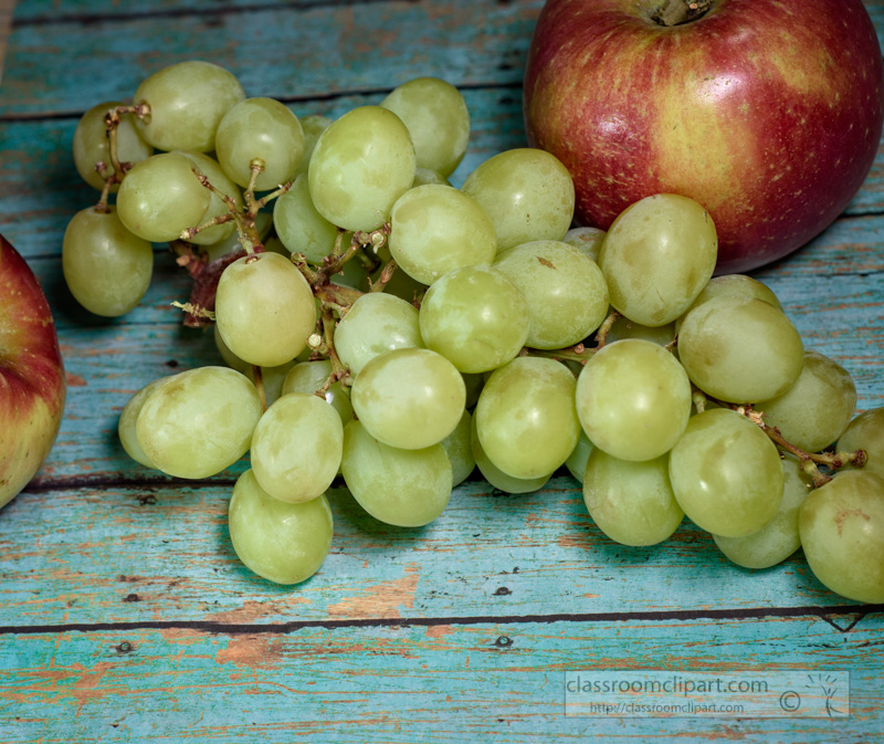 vitamin-filled-green-grapes-with-red-apple-wood-background-photo-1e.jpg