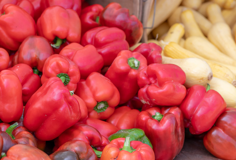pile-of-plump,-fresh-red-bell-peppers-at-a-vegetable-stand-147-2.jpg