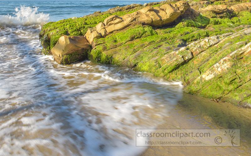waves-breaking-on-green-seaweed-covered-rocks-photo-6751.jpg