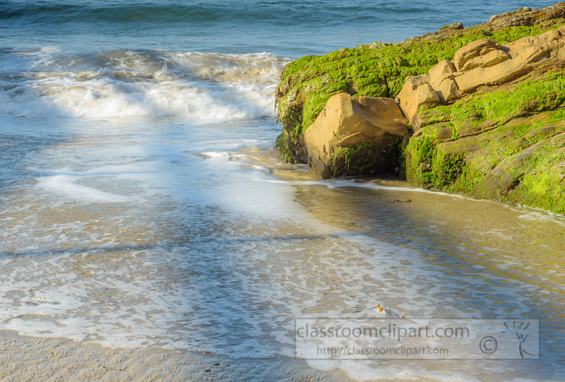 waves-with-green-algae-covered-coastal-rock.jpg