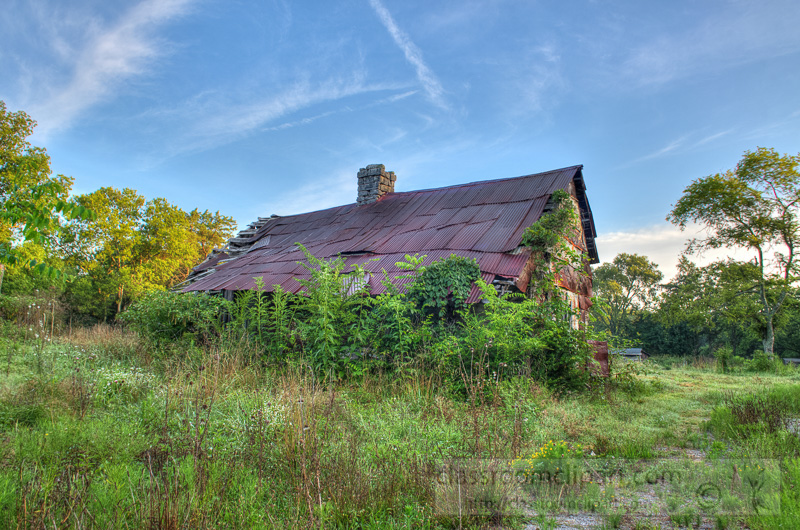 old-building-with-rusted-metal-roof-with-plants-growing-on-structure-photo-image-88572.jpg