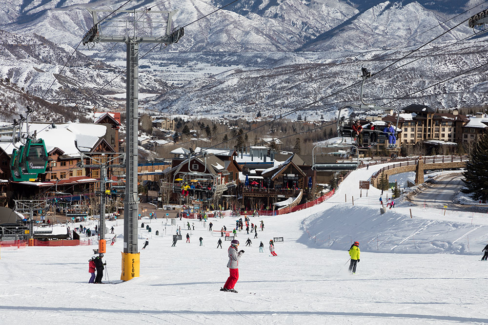 skiers-on-mountain-with-view-of-resort.jpg