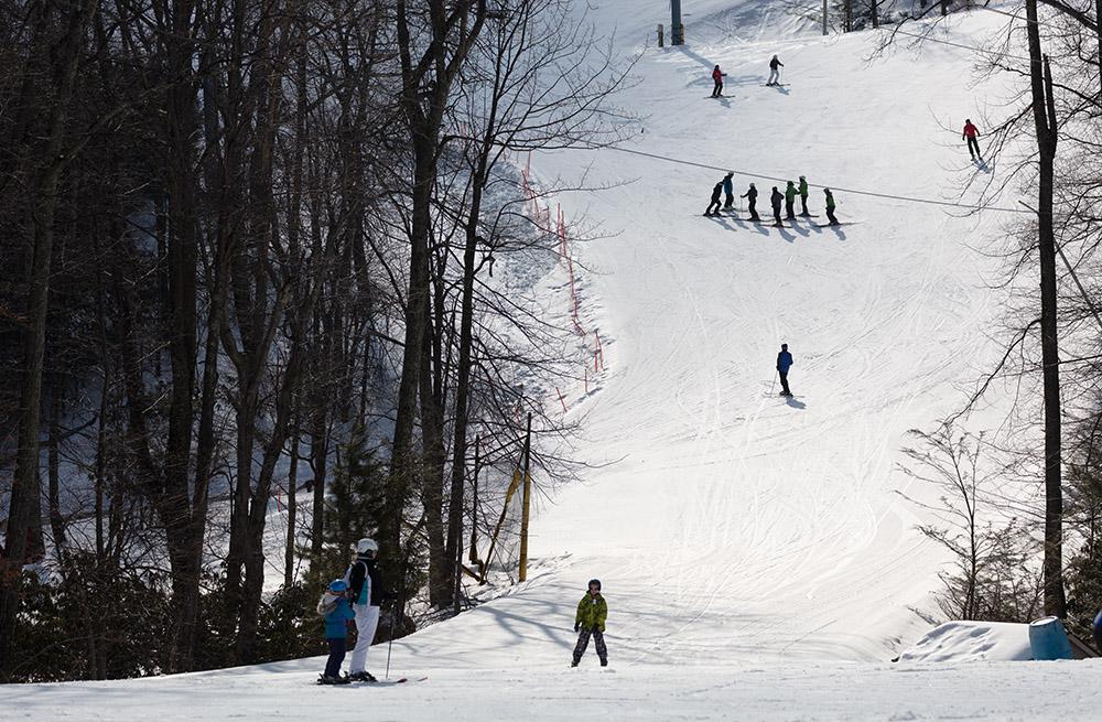 skiiers-gathered-on-mountain-slope-in-colorado.jpg