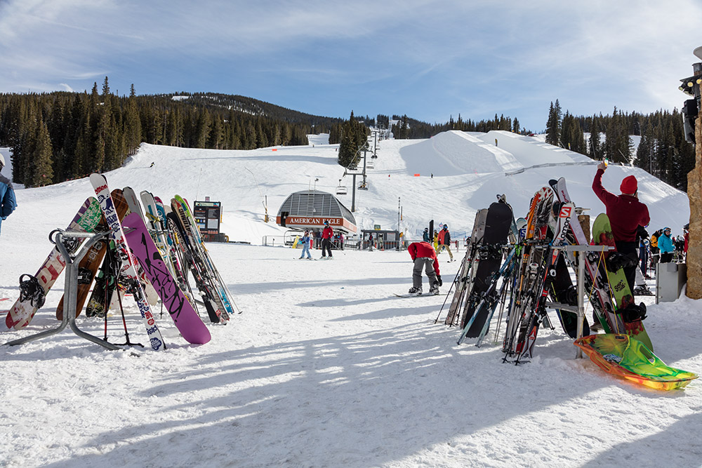 skiis-and-snowboards-lined-up-at-mountain-resort-in-colorado.jpg