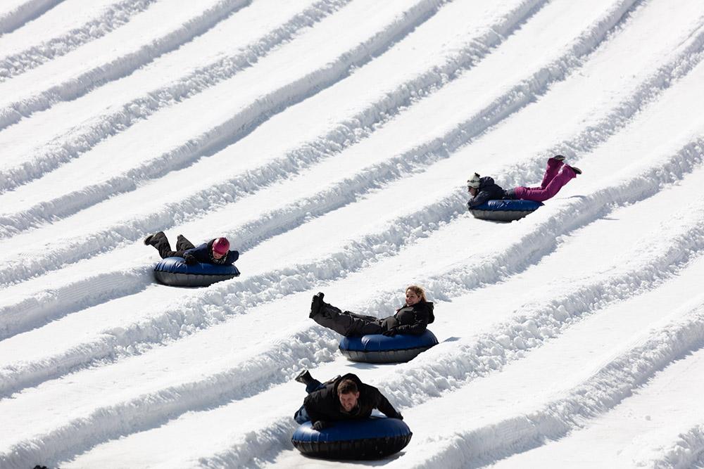 snow-tubers-enjoying-run-down-mountain-in-colorado.jpg