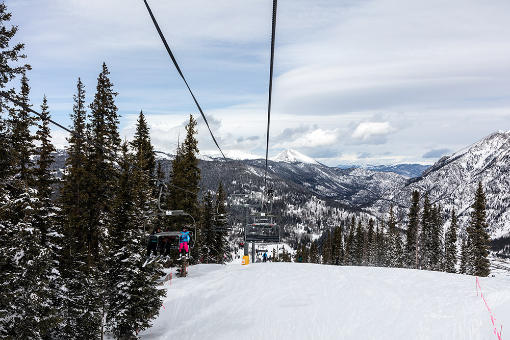 view-down-snow-filled-mountain-with-chair-lift.jpg