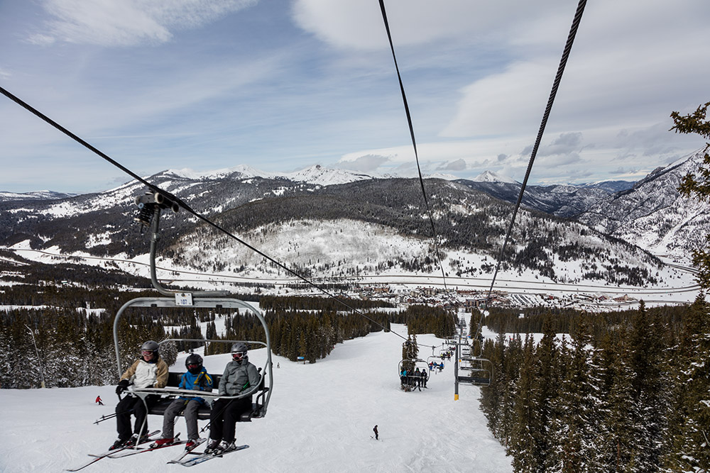 view-of-chair-lift-with-skiers-and-snowboarders.jpg