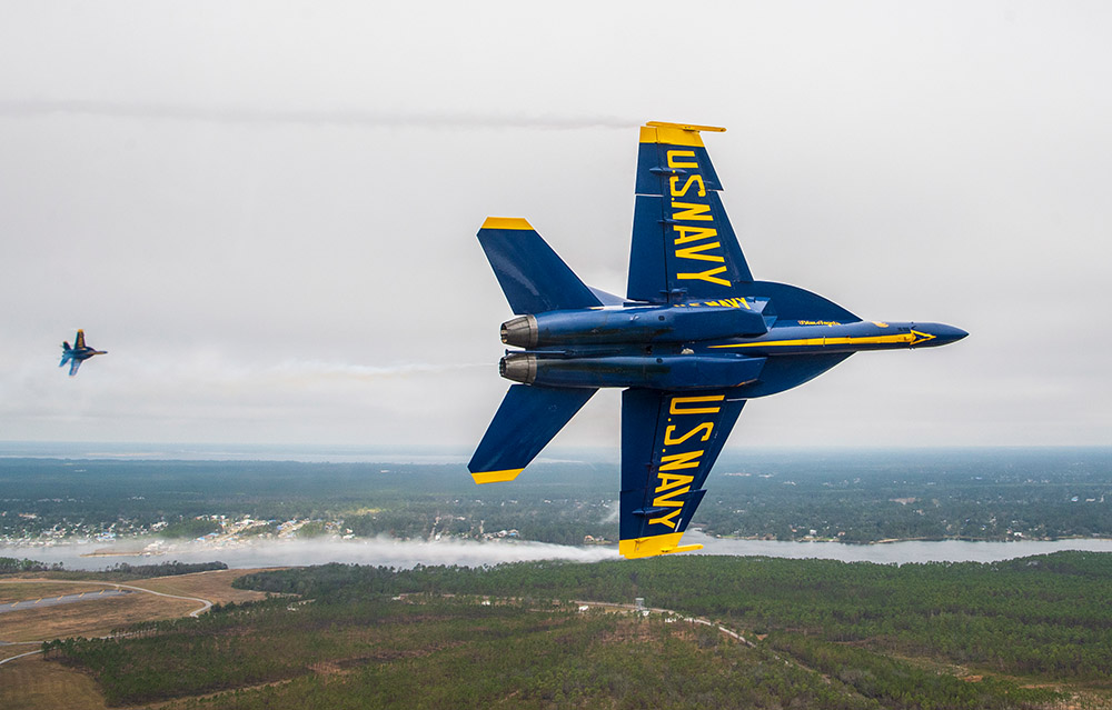 blue-angels-conducts-the-pitch-up-break-maneuver-during-a-training-flight-over-pensacola-florida.jpg