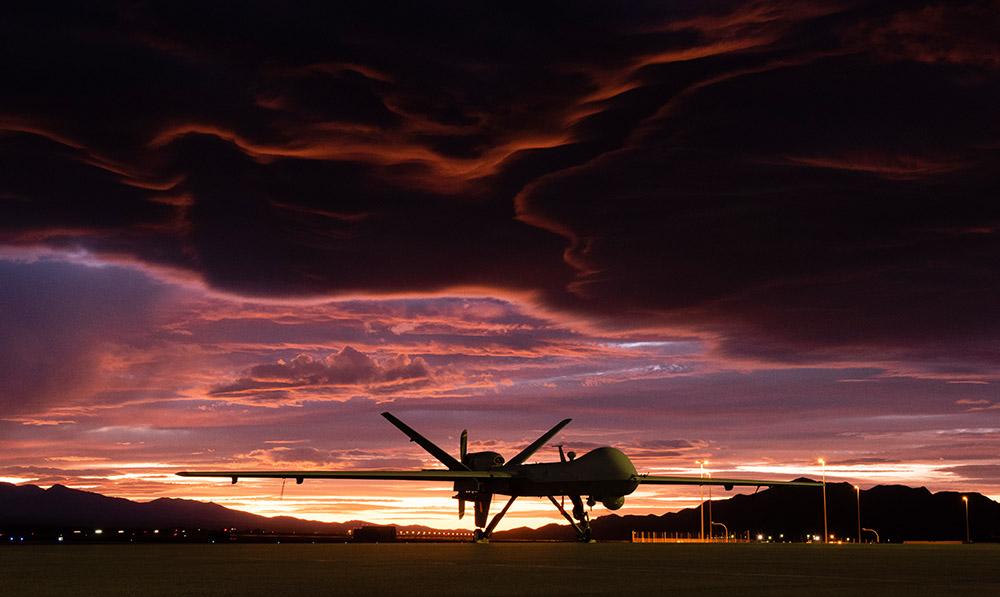 mq-9-reaper-sits-on-the-flightline-as-the-sun-sets.jpg