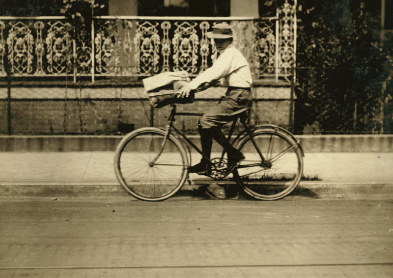 historic photo delivery boy on a bicyle.jpg