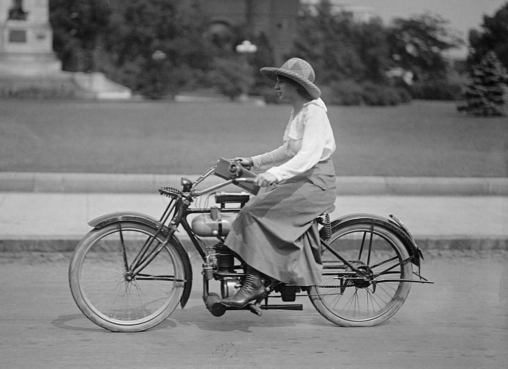 woman-riding-bicycle-1918.jpg