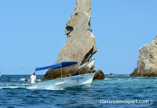 boat_near_rock_formation.jpg