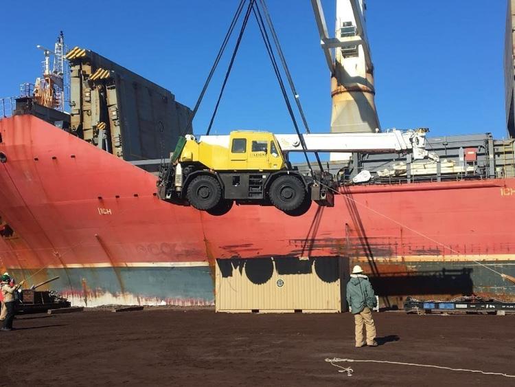 loading-of-a-crane-onto-a-cargo-ship-in-antarctica-885-photo.jpg