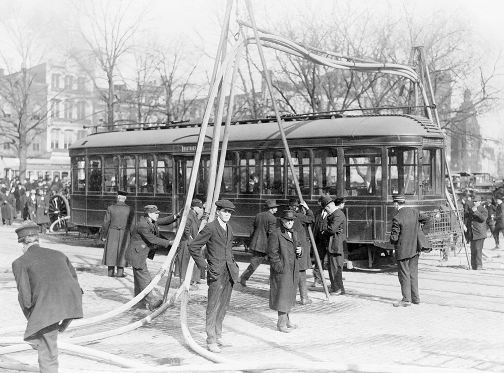 firemen-with-hoses-over-streetcar-1925.jpg