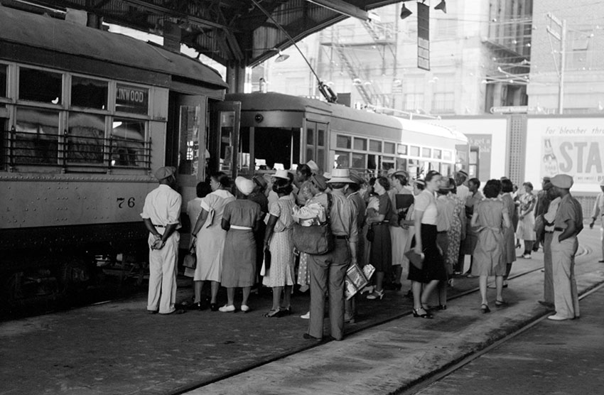 people-entering-exiting-a-streetcar-in-a-terminal-oklahoma-1939.jpg