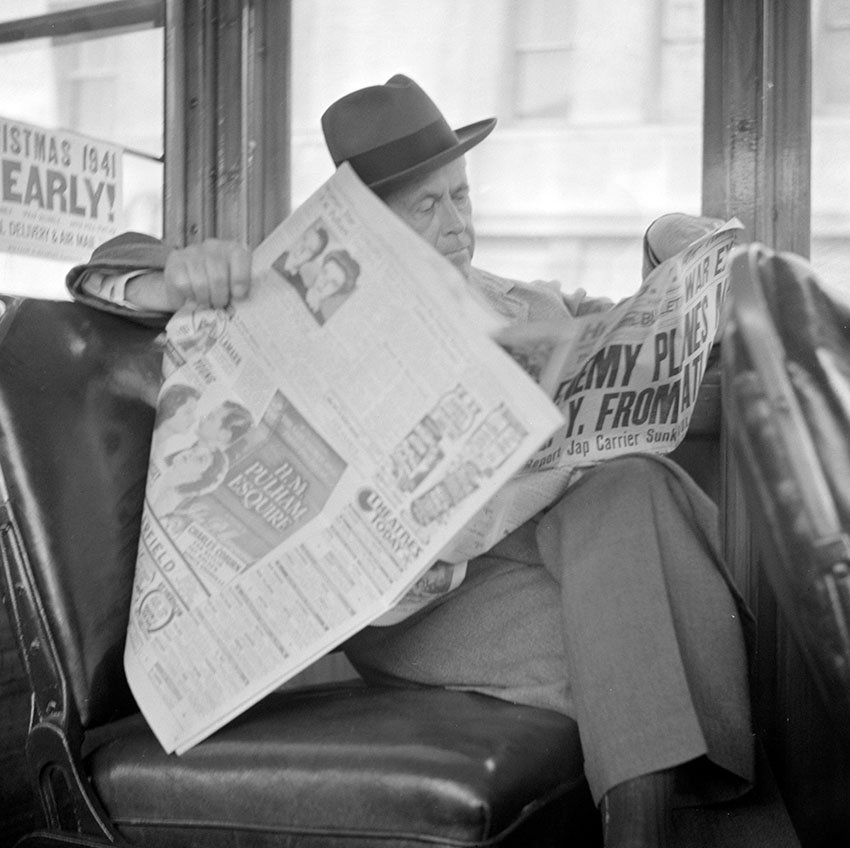 reading-war-news-while-riding-on-streetcar-in-san-francisco-1941.jpg