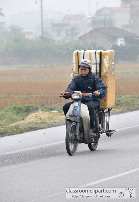 vietnamese_man_on_motorcyle.jpg