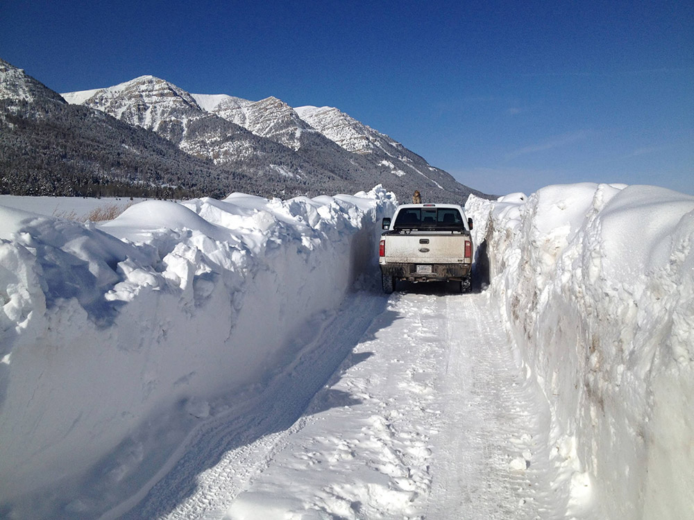 high-snow-banks-on-snow-covered-roadway.jpg