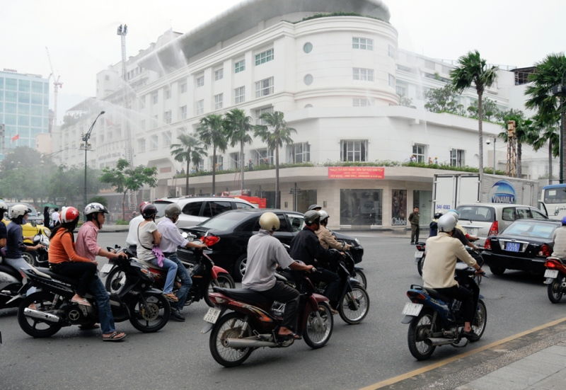 motorcycles-lined-up-along-streets-in-busy-vietnam.jpg