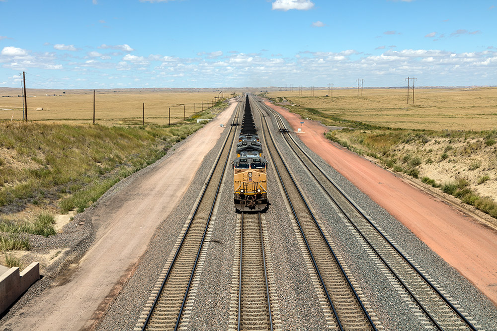 fright-train-approaching-city-in-wyoming.jpg