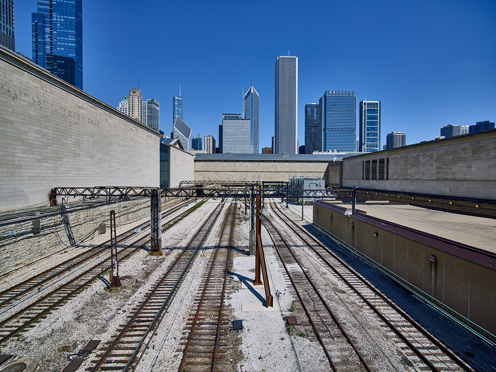 snow-covered-train-tracks-leading-to-downtown-chicago,.jpg