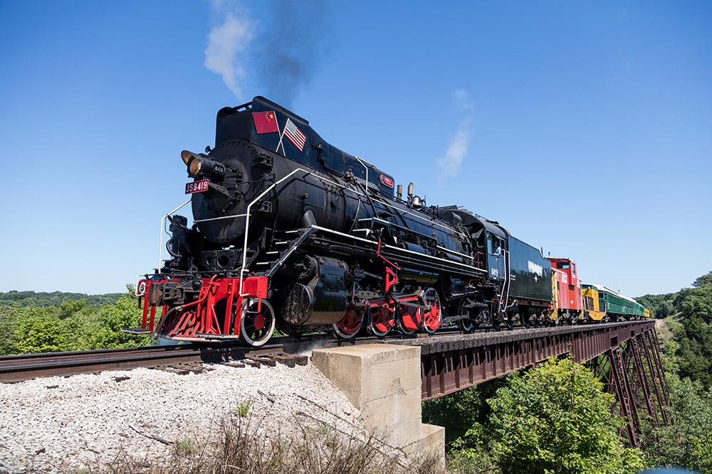 steam-train-crossing-over-trestle-bridge.jpg