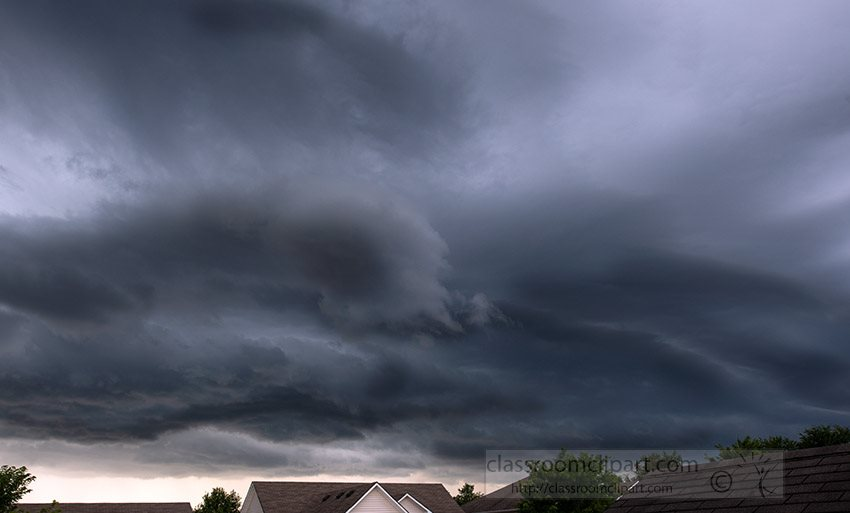 sky-large-dark-storm-clouds-over-homes.jpg