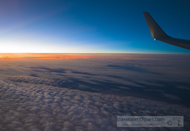 view-of-stratocumulus-clouds-sun-rising-from-commercial-aircraft-photo-8501712.jpg